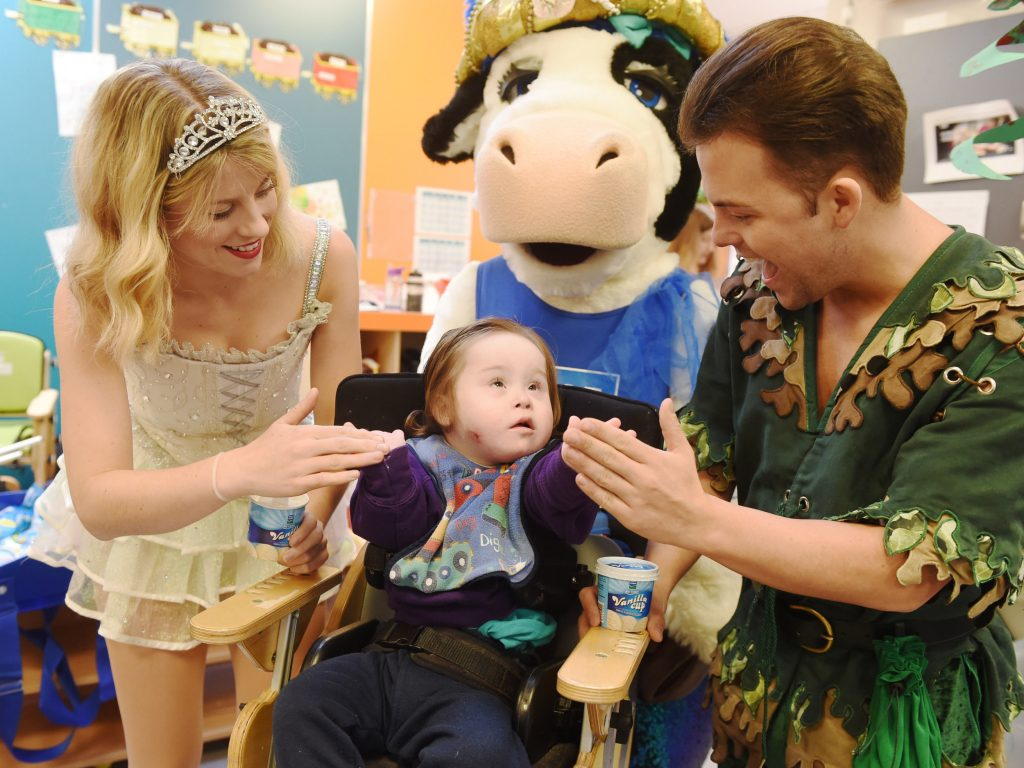 Ben from West Belfast (aged 2) enjoying a special delivery of Dale Farm ice cream and lollies with Peter Pan (Mikey Jay-Heath), Dale Farm Mascot 'Bella' and Tinkerbell (Hollie O'Donoghue)